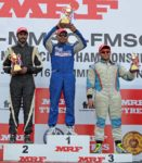 Deepak Paul Chinnappa (centre), winner of the Indian Touring Cars race flanked by Arjun Narendran (left) who finished and second and third placed Ashish Ramaswamy (July 17)